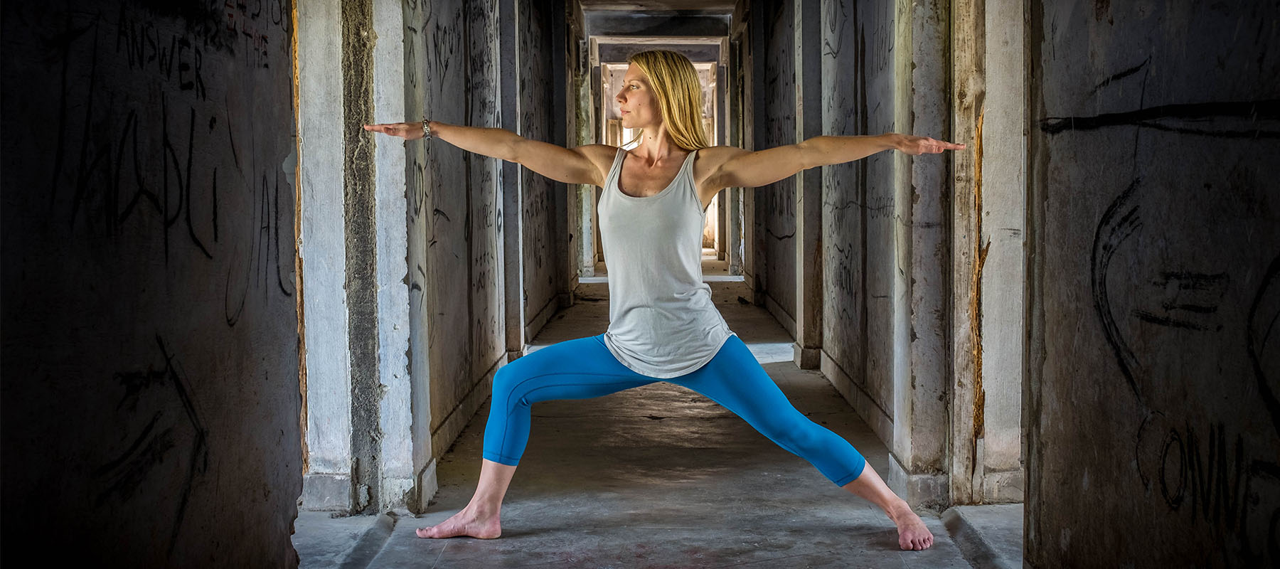 Helen Clare in a yoga warrior 2 pose